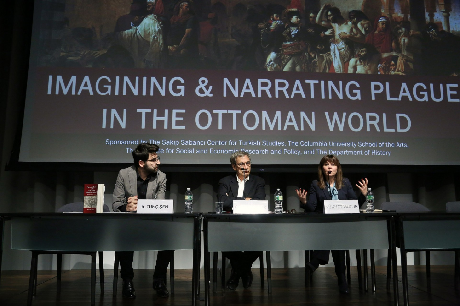 "A. Tunç Şen, Orhan Pamuk, and Nükhet Varlık speak on stage for event ""Imagining and Narrating Plague in the Ottoman World"""